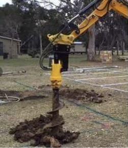 Jordborr minigrävare används för att sätta plint